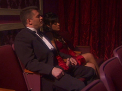Dark haired bombshell Kaylani Lei gives a handjob to some bloke in a theatre