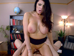Busty scrimshaw Romi Rain actively rides boss' XXX dick in excess of table