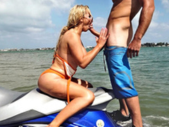 Nikki Benz with respect to sunglasses sits on jet ski and gives XXX oral job in sight